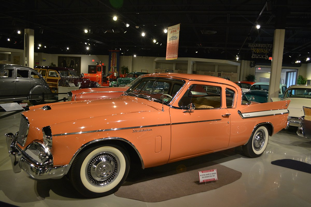 The Museum's 1961 Hawk sits in the Second Floor Gallery. The car is painted in Studebaker's Flamingo color, an orange/tangerine shade.