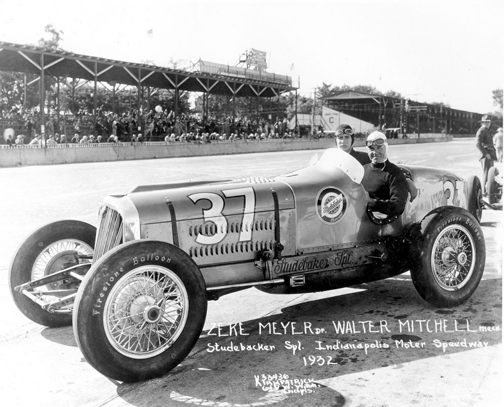 Indy 500 driver Zeke Meyer sits in the #37 Studebaker Special in front of the stands at the 1932 Indianapolis 500