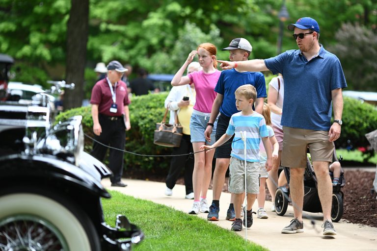 A family of 6 enjoys the Concours d'Elegance at Copshaholm